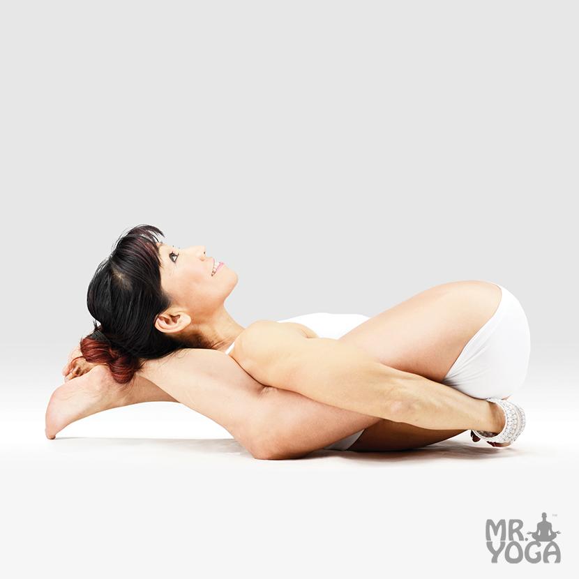 Yoga-Pose-Hands-Bound-Yogic-Sleep-Pose-Baddha-Hasta-Yoganidrasana ...