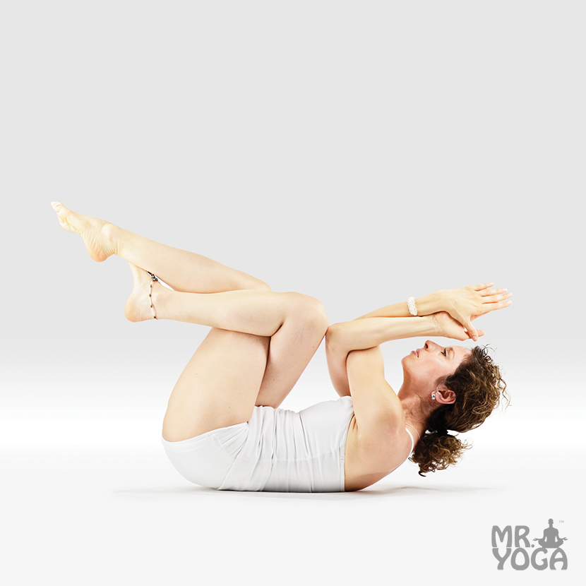 Yoga-Pose-Reclining-Abdominal-Lift-Pose-Dedicated-to-Garuda-Supta-Jathara-Garudasana