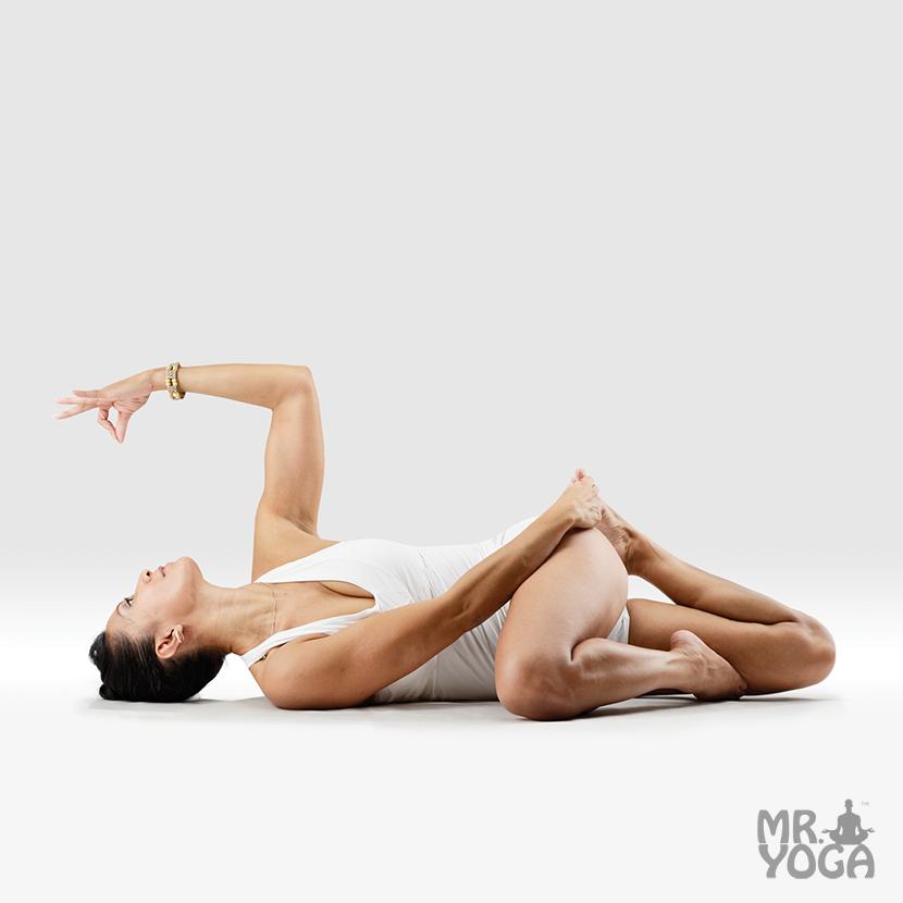 Yoga-Pose-Svastika-Legs-in-Twisted-Stomach-Pose-Pada-Svastikasana-in-Jatara-Parivartanasana